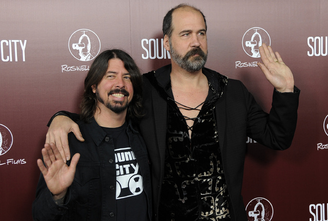 """Dave Grohl, left, poses with Nirvana bandmate Krist Novoselic at the premiere of the documentary film """"Sound City"""" in Los Angeles. Nirvana will be inducted into the 2014 Rock and Roll Hall of Fame ..."""