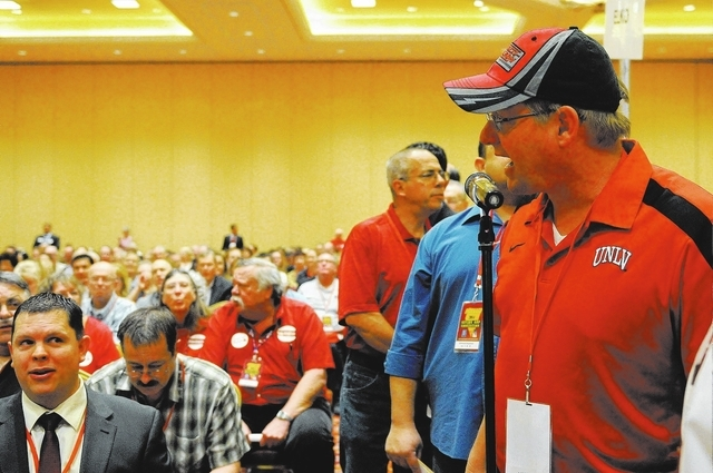 Steve Evenson, right, delegate of the Nevada Republican Party, speaks gives his opinion on an amendment during the annual Nevada Republican Party convention at the South Point casino-hotel in Las  ...