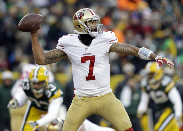 San Francisco 49ers quarterback Colin Kaepernick (7) throws a pass during the first half of an NFL wild-card playoff football game against the Green Bay Packers, Sunday, Jan. 5, 2014, in Green Bay ...