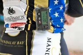 Triathlete  wears a glucose monitor and an insulin pump to check and control his blood glucose levels during a race.