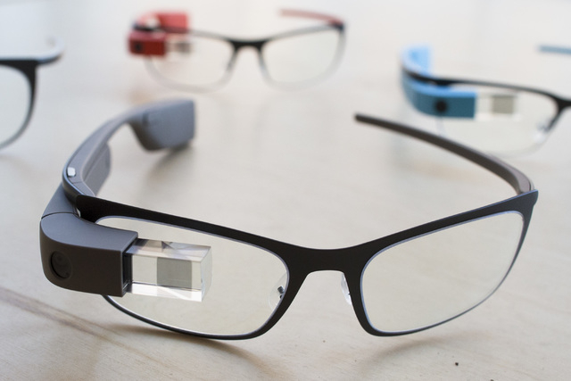 "The new Google Glass ""Bold"" prescription frames in ""shale"" color rests on a table at the Google Glass Basecamp space at Chelsea Market, Friday, Jan. 24, 2014, in New York. (AP  ..."