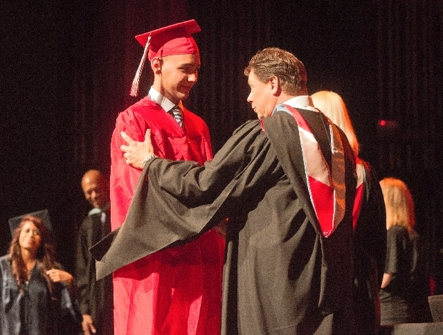 Clark County School District Superintendent Pat Skorkowsky congratulates Western High School student Angel Peraza-Lezcano ,19, during autumn graduation at the Theater of the Las Vegas Academy of I ...