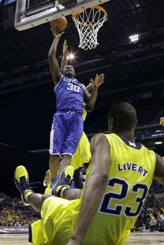 Kentucky freshman forward Julius Randle shoots during the Wildcats' 75-72 win over Michigan in the Midwest Regional final Sunday at Indianapolis. All five Kentucky starters are freshmen. (AP Pho ...