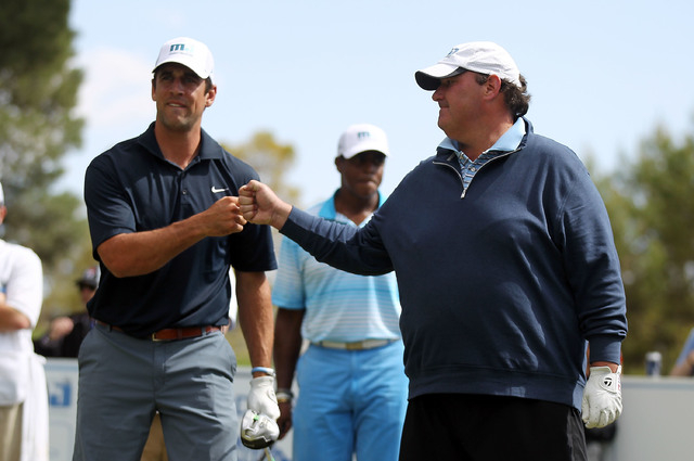 NFL player Aaron Rodgers, left, and actor Brian Baumgartner fist bump during the 13th Annual Michael Jordan Celebrity Invitational at Shadow Creek. (Isaac Brekken/Getty Images)