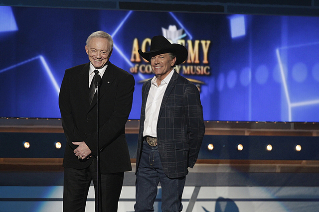Jerry Jones, left, and George Strait are shown Sunday during the 49th Annual Academy of Country Music Awards in the MGM Grand Garden arena. (Francis Specker/CBS)