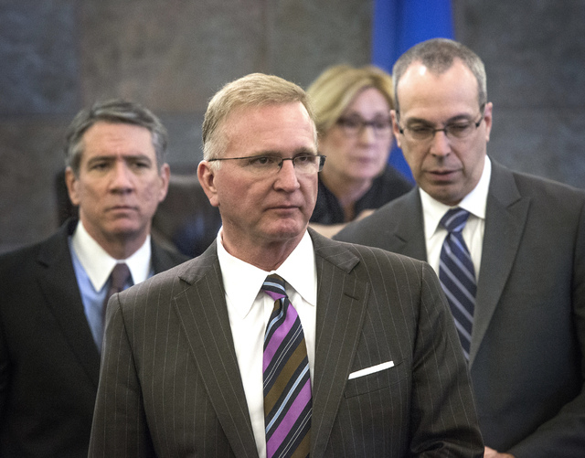 Defense attorney Daniel Polsenberg, left, plaintiffs attorney Robert Eglet and David Wall as seen after a sidebar with Judge Kerry Earley during a multibillion dollar lawsuit against Takeda Pharma ...