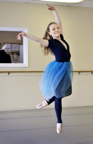"""Aida Francesca Garcia, as Alice, dances during a Las Vegas Contemporary Dance Theater rehearsal for """"Alice Down the Rabbit Hole"""" at the Kravenko Youth Ballet and Academy of Dance at 2555 ..."""