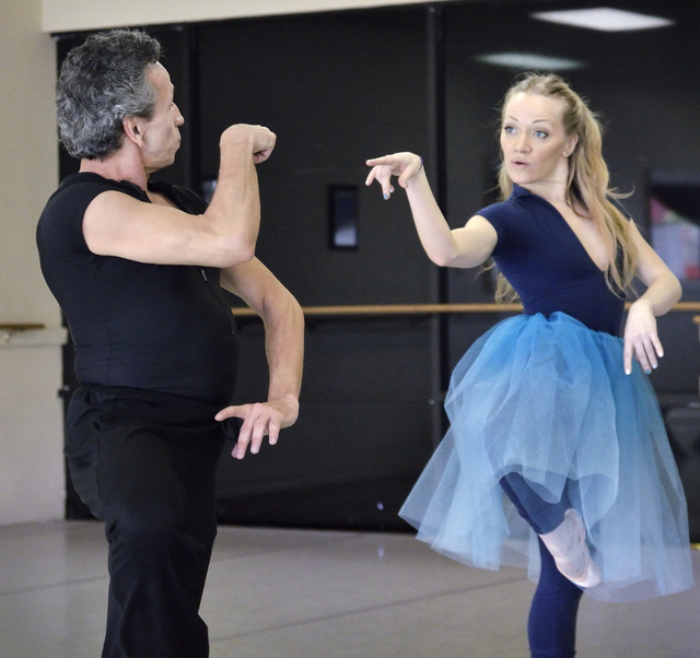 """Eddie Otero, as the Caterpillar, left, and Aida Francesca Garcia, as Alice, perform during a Las Vegas Contemporary Dance Theater rehearsal for """"Alice Down the Rabbit Hole"""" at the Kraven ..."""