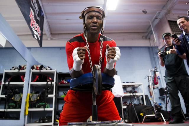 In this April 10, 2014 photo, IBF light heavyweight boxing champion Bernard Hopkins lifts a weight during a media workout Thursday, April 10, 2014, in Philadelphia. Hopkins will attempt to become  ...