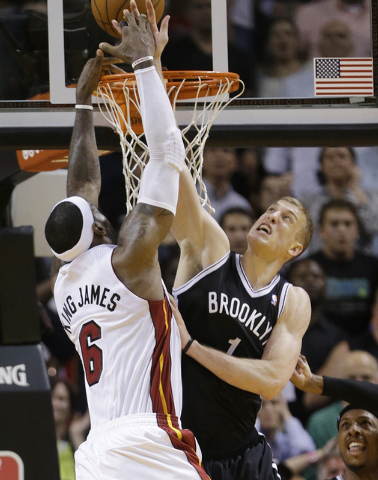 Brooklyn Nets forward Mason Plumlee (1) blocks a shot by Miami Heat forward LeBron James (6) in the final seconds of a game on Tuesday night in Miami. The Nets defeated the Heat 88-87. (AP Photo/W ...
