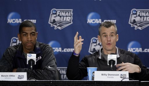 Florida coach Billy Donovan, right, speaks alongside Connecticut coach Kevin Ollie at a joint news conference Thursday in advance of the teams' NCAA Tournament semifinal to be played Saturday at ...