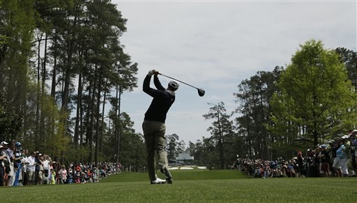 Former UNLV star and defending Masters champion Adam Scott tees off on the seventh hole during a practice round for the Masters golf tournament Tuesday, April 8, 2014, in Augusta, Ga. (AP Photo/Ch ...