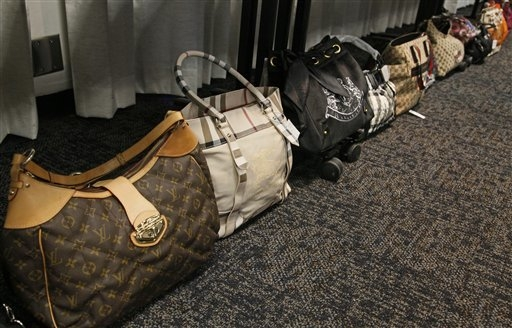 Counterfeit hand bags are displayed at a news conference at the Sherman Block Sheriffs Headquarters in Los Angeles in December. (AP Photo/Nick Ut)