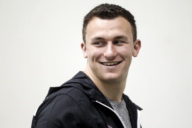 Johnny Manziel reportedly did very well on an intelligence quiz at the NFL scouting combine.  (AP File Photo/Patric Schneider)