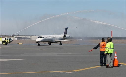 The first United Airlines flight from Chicago is welcomed by water cannons after landing at Atlantic City International Airport in Egg Harbor Township, N.J.,  Tuesday April 1, 2014. The airline wi ...