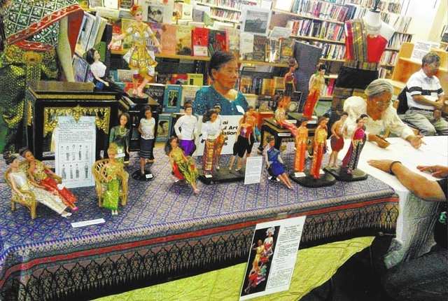 Dolls dressed in traditial costumes from Thailand sit on display at the 2013 Asian Pacific Dreams Festival at the Green Valley Library. (Special to View)