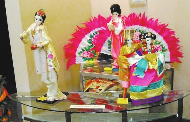 Dolls display traditional costumes at the 2013 Asian Pacific Dream Festival at the Green Valley Library. (Special to View)