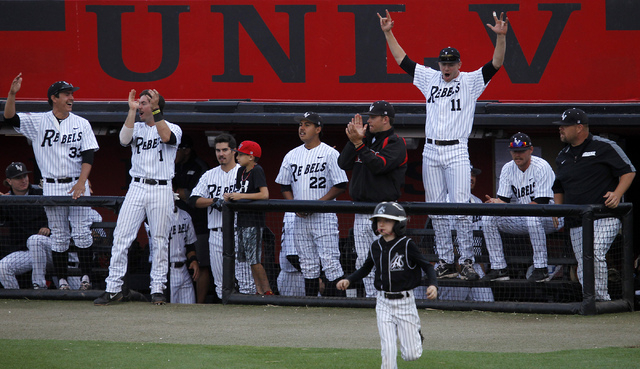 The UNLV bench celebrates as they score 6 runs during the first inning while taking on New Mexico during their baseball game at Earl E. Wilson Stadium in Las Vegas on April 25, 2014. (Jason Bean/L ...