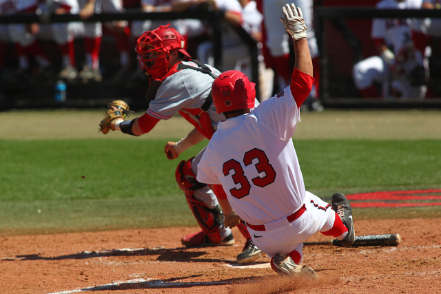 UNLV's Jonathan Torres (33) slides into home in the sixth inning during a baseball game against New Mexico at Earl E. Wilson Stadium in Las Vegas on Sunday, April 27, 2014. UNLV won 14-2. (Chase S ...