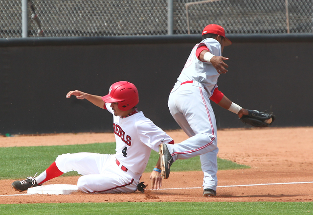 UNLV's Matt McCallister (4) slides into third base past New Mexico's Andre Vigil (25) in the third inning during a baseball game at Earl E. Wilson Stadium in Las Vegas on Sunday, April 27, 2014. U ...