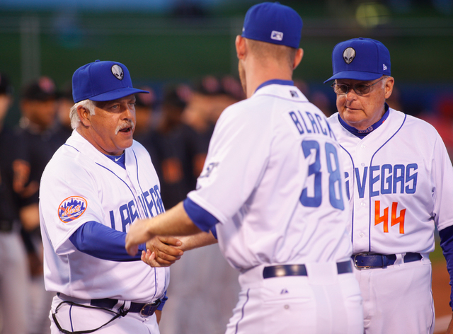 Las Vegas 51s manager Wally Backman, left, shakes hands with relief pitcher Vic Black (38) as hitting coach George Greer looks on during Opening Day player introductions at Cashman Field on Thursd ...