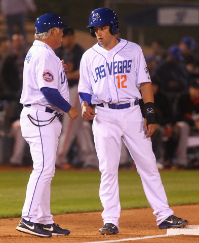 Las Vegas 51s Manager Wally Backman, left, talks with Daniel Muno at third base as the team plays against the Fresno Grizzlies at Cashman Field on Thursday, April 3, 2014. (Chase Stevens/Las Vegas ...
