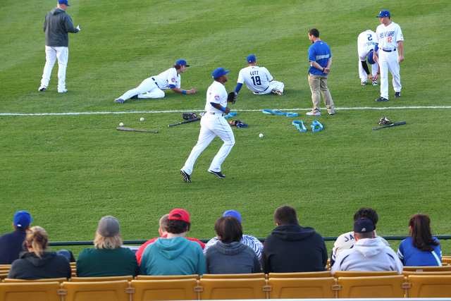 Las Vegas 51s players warm up before taking on the Fresno Grizzlies at Cashman Field on Thursday, April 3, 2014. (Chase Stevens/Las Vegas Review-Journal)