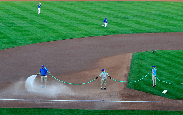 Cashman Field groundskeeper Kevin Moses, left, sprays water on the infield with help from his crew before a 51s game against Sacramento this week. Moses, who was hired in January, has received wid ...