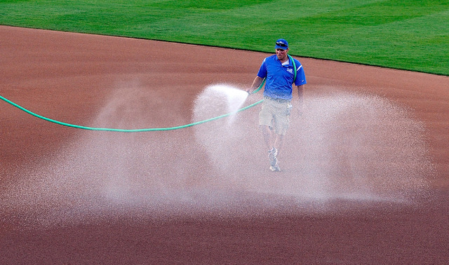 Grounds manager Kevin Moses sprays water on the infield before the start of a Las Vegas 51s minor league baseball game against Sacramento at Cashman Field on Monday, April 7, 2014. (David Becker/L ...
