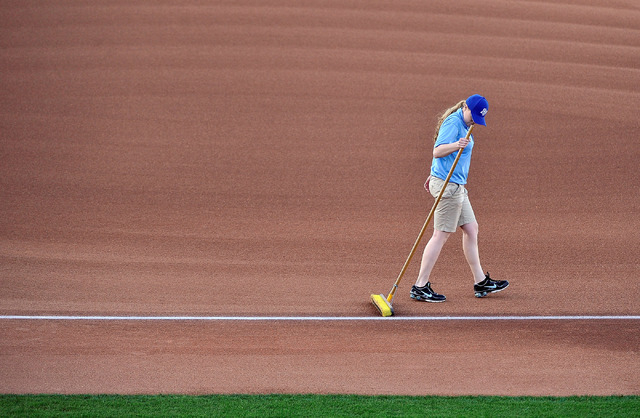 Grounds worker Casey Scheller uses a push broom to maintain the infield before the start of a Las Vegas 51s minor league baseball game against Sacramento at Cashman Field on Monday, April 7, 2014. ...