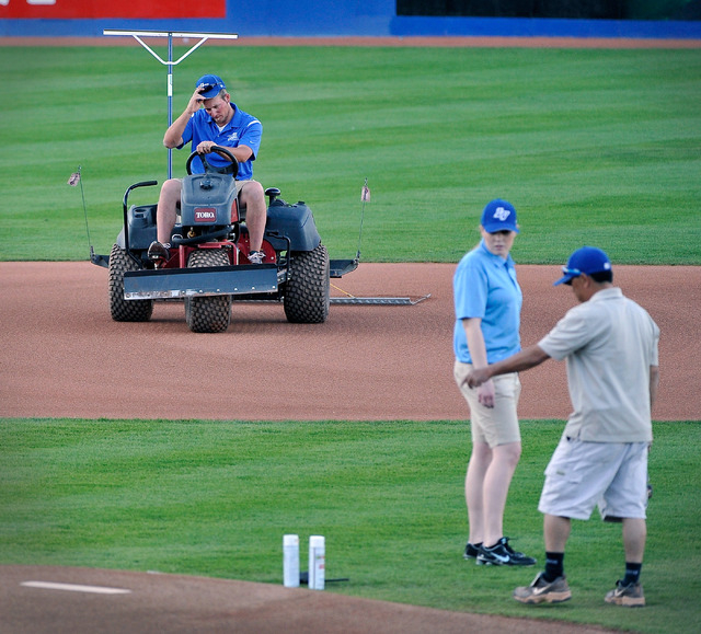 Grounds manager Kevin Moses, left, drags the infield as his crew works on the pitchers mound before the start of a Las Vegas 51s minor league baseball game against Sacramento at Cashman Field on M ...