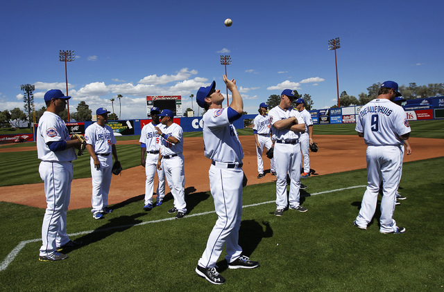 Las Vegas 51s' catcher Taylor Teagarden, middle, tosses a baseball to himself before the official team photo was taken during the organized media day at Cashman Field on Tuesday. The 51s open the  ...