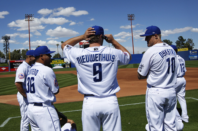 Outfielder Kirk Nieuwenhuis (9) adjusts his cap before the official team photo was taken during the organized media day at Cashman Field on Tuesday. (Jason Bean/Las Vegas Review-Journal)