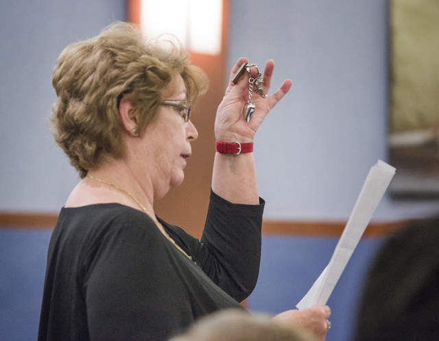 Margaret Compehos, mother of Lawrence Compehos Jr., holds the ashes of her son during the sentencing of Sergio Garcia-Carrizales at Regional Justice Center on Wednesday, April 9, 2014. Garcia-Carr ...