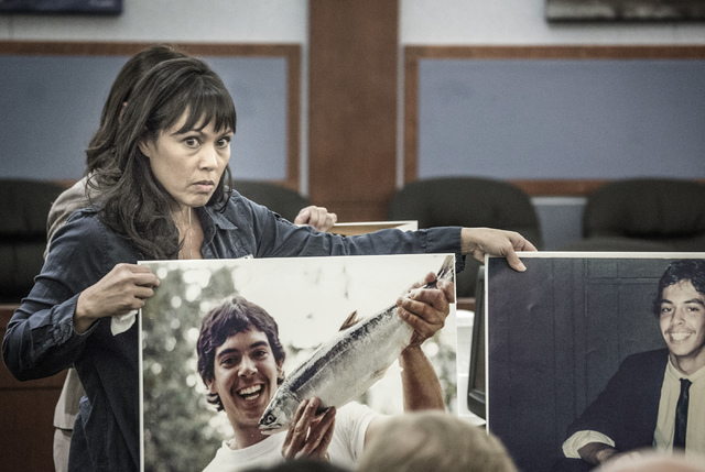Sonya Compehos Henney, sister of Lawrence Compehos Jr., holds photos of her brother during the sentencing of Sergio Garcia-Carrizales at Regional Justice Center on Wednesday, April 9, 2014. Garcia ...