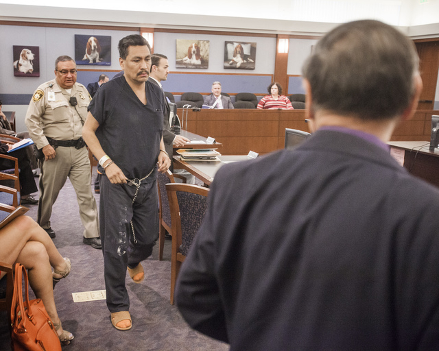 Sergio Garcia-Carrizales exits Judge Kathleen E. Delaney's courtroom to confer with his attorney at Regional Justice Center on Wednesday, April 9, 2014. He was sentenced to a maximum five years in ...