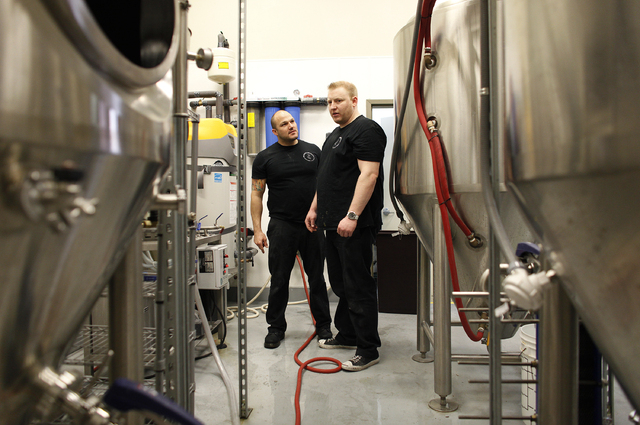 Marc Longwith, left, and Michael Beaman work in the brewery at Banger Brewing in downtown Las Vegas on April 4. (John Locher/Las Vegas Review-Journal)