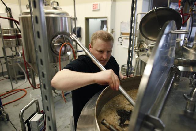 Michael Beaman stirs mash in the brewery at Banger Brewing in downtown Las Vegas. (John Locher/Las Vegas Review-Journal)