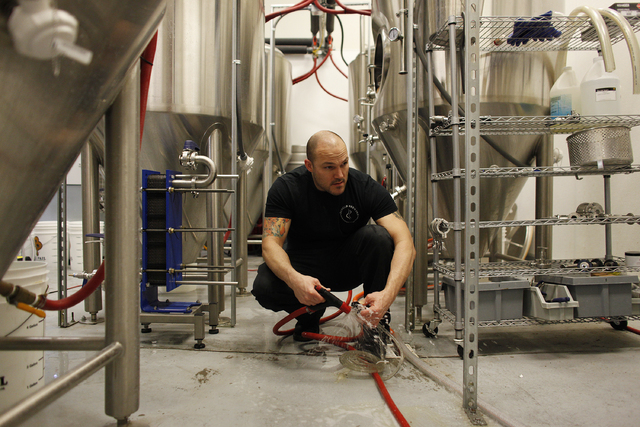 Marc Longwith cleans out equipment at Banger Brewing. (John Locher/Las Vegas Review-Journal)