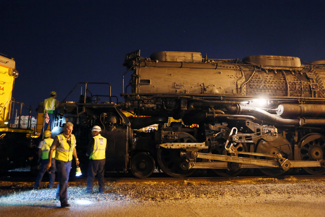 A crew inspects Big Boy No. 4014 moments after the historic steam locomotive arrives at Union Pacific Tuesday, April 29, 2014, in Las Vegas.  (Ronda Churchill/Las Vegas Review-Journal)