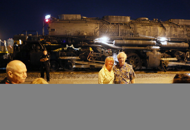 Marion, center, and Jess Meyers stand for a personal photo near Big Boy No. 4014 after the historic steam locomotive arrives at Union Pacific Tuesday, April 29, 2014, in Las Vegas.  (Ronda Churchi ...