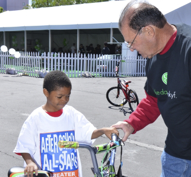 Elijah (last name withheld) from West Prep Academy receives a bicycle at the 11th annual PK Bike Day. (Special to View)