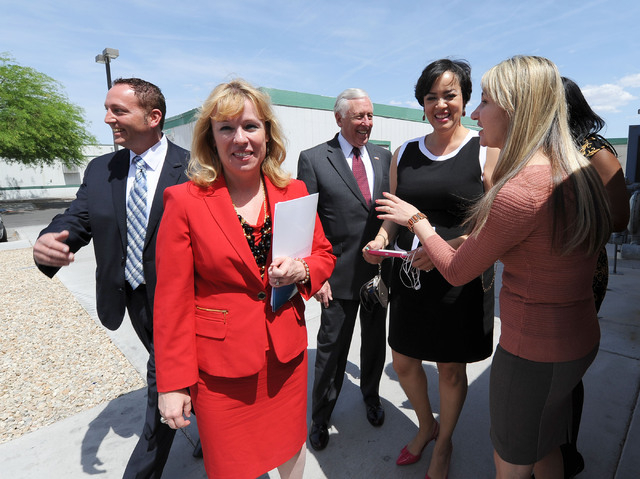 Nevada congressional candidate Erin Bilbray, second from left, talks with Ana Puljic, assistant director of employee and student services, right, as they tour the Culinary Training Academy in Las  ...