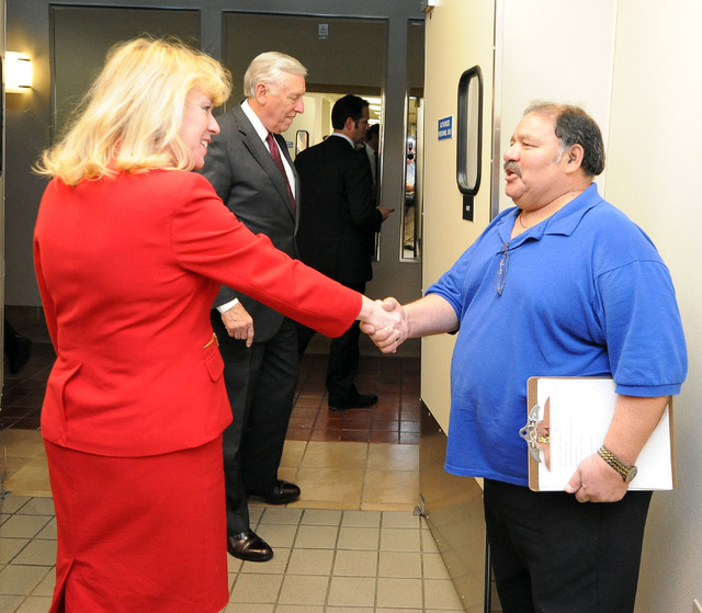 Nevada congressional candidate Erin Bilbray shakes hands with Steward Supervisor Geardo Quiralte as she tours the Culinary Training Academy in Las Vegas, Monday, April 21, 2014. U.S. House minorit ...