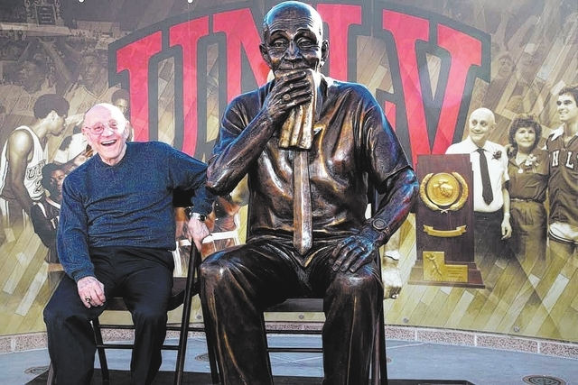 Jerry Tarkanian sits with his likeness after the unveiling of his statue at UNLV's Thomas & Mack Center outdoor plaza on Wednesday Oct. 30, 2013. (Alex Federowicz/Las Vegas Review-Journal)