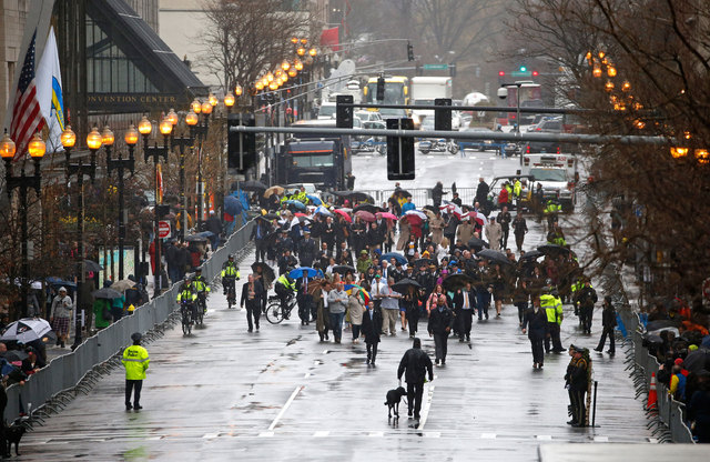 Family members and survivors of the 2013 Boston Marathon bombing walk down Boylston Street for a remembrance ceremony at the finish line on the one year anniversary, Tuesday, April 15, 2014, in Bo ...