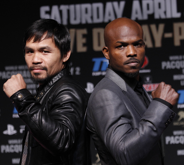 Fighters Timothy Bradley, right, and Manny Pacquiao pose during a press conference prior to their rematch at the MGM Grand in Las Vegas on April 9, 2014. (Jason Bean/Las Vegas Review-Journal)