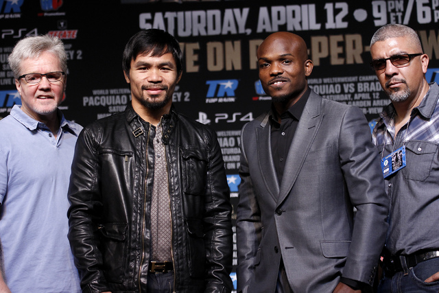 From left, trainer Freddie Roach, Manny Pacquiao, Timothy Bradley and trainer Joel Diaz pose during a press conference prior to their rematch at the MGM Grand in Las Vegas on April 9, 2014. (Jason ...