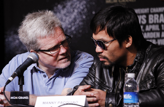 Fighter Manny Pacquiao, right, talks with his trainer Freddie Roach during a press conference prior to his rematch with Timothy Bradley at the MGM Grand in Las Vegas on April 9, 2014. (Jason Bean/ ...