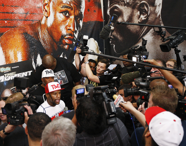 Boxer Floyd Mayweather Jr. talks to the media in preparation for his upcoming fight against Marcos Maidana at his gym in Las Vegas on April 22, 2014. (Jason Bean/Las Vegas Review-Journal)